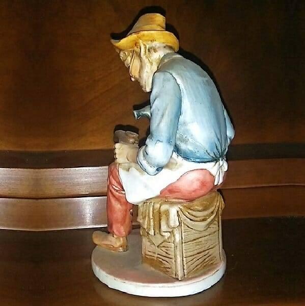 Vintage Cobbler Figurine back view
