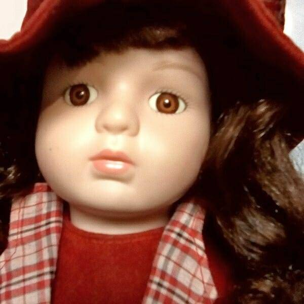 Brunette Doll On Stand face close up