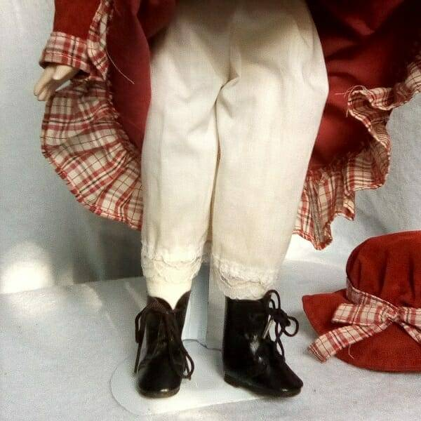 Brunette Doll On Stand legs close up