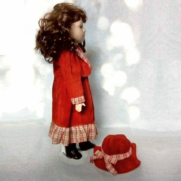 Brunette Doll On Stand side view